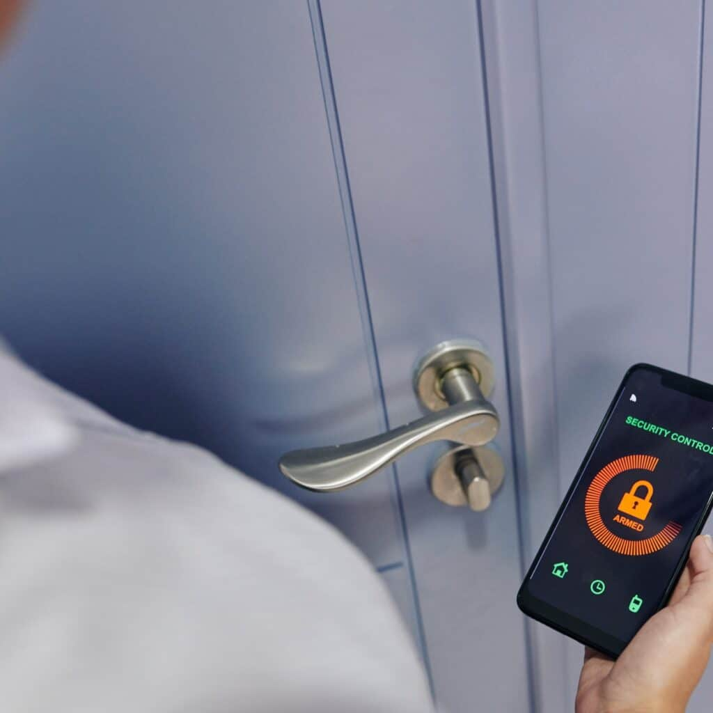 Woman using security control app